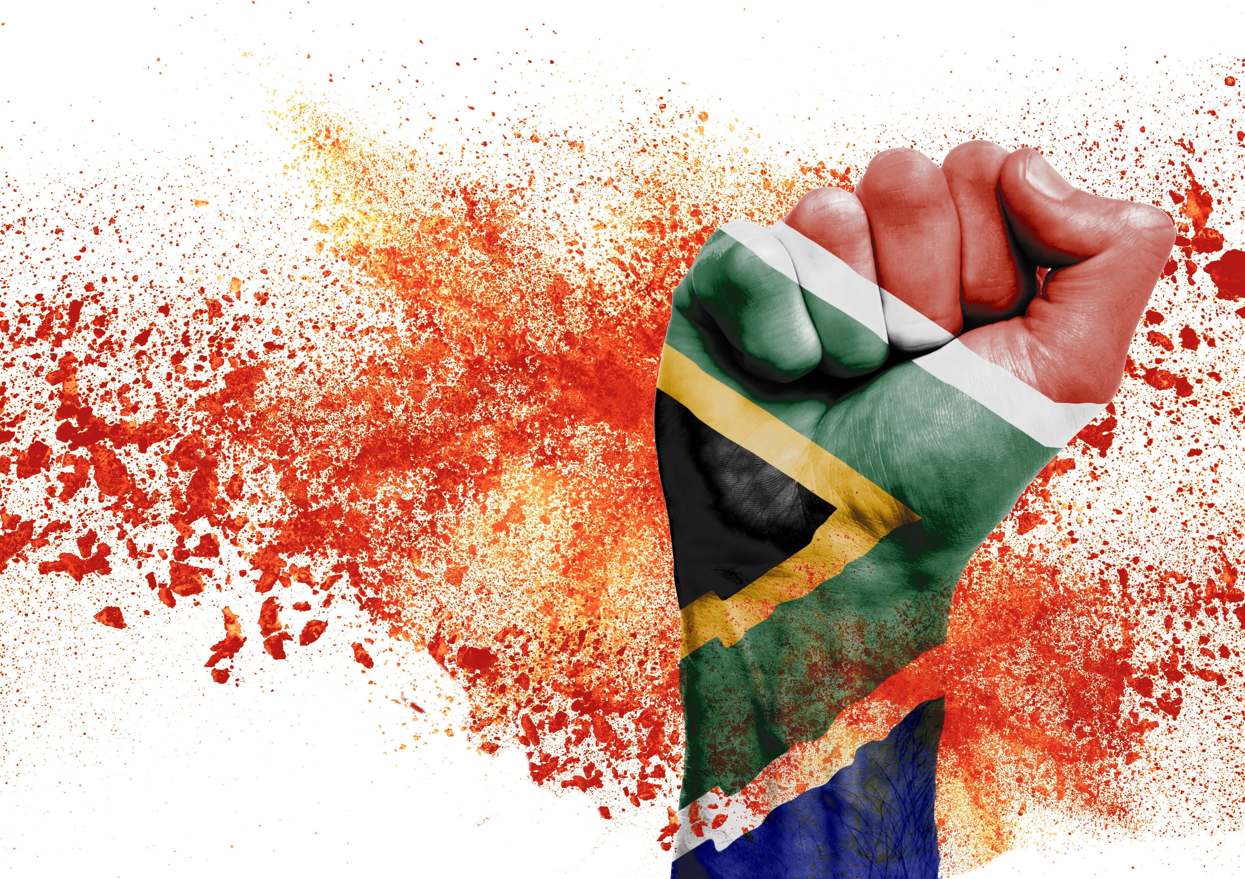 A picture of a hand with a south african flag painted on it and orange spray of paint in the background